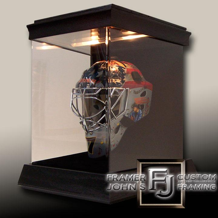 GOALIE HELMET IN CUSTOM LIT DISPLAY CASE